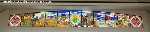 A stained glass window at the entrance to the cathedral, showing symbols of Zamboanga City
