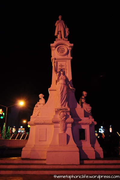 "Zamboanga City's Rizal Park. Every city is mandated by law to have a statue dedicated to our national hero. This one also features representations of virtues (such as ""libertad"") and bas reliefs of characters from the Noli and Fili."