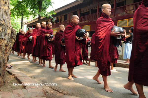 Young monks lining up for noontime meals at the Mahagandhayon Monastic Institution in Amarapura
