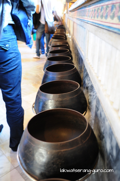 Bronze bowls into which visitors can put donations