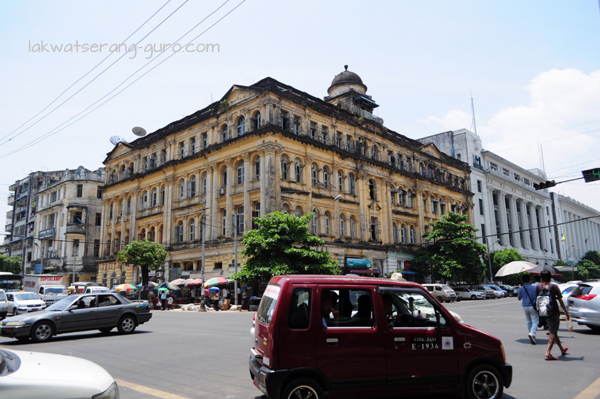Yangon is filled with beautiful, crumbling colonial buildings...and cars.