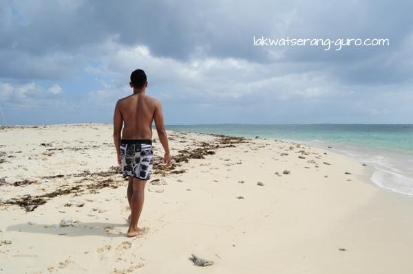 Edison walking along the shore of little Naked Island