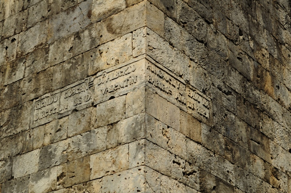 An inscription on the walls of the church. The walls are made of coral stone.