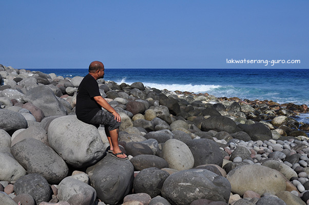 Valugan Boulder Beach (with husband posing contemplatively, at my insistence)